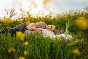 Romantic couple lying in the flower
