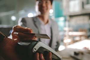 Businessman paying with contactless