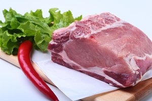 Raw pork chops with herbs and spices