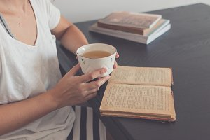 Old book and vintage mug