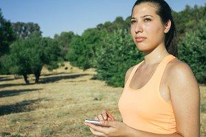 Runner woman using her phone