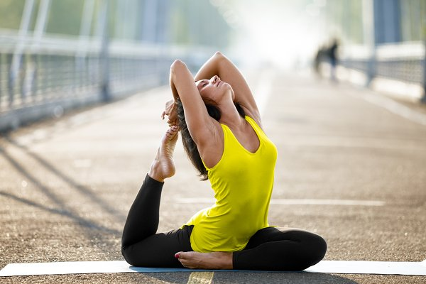 Woman doing stretching yoga exercis…