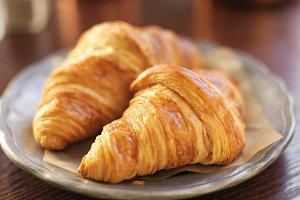 two croissants on rustic plate