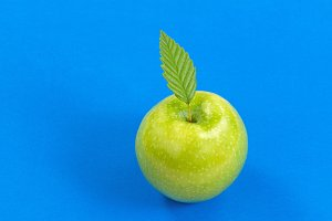 Green Apple on blue background
