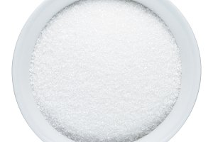 Sugar in bowl isolated on white