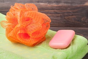 towel with sponge shower and soap on