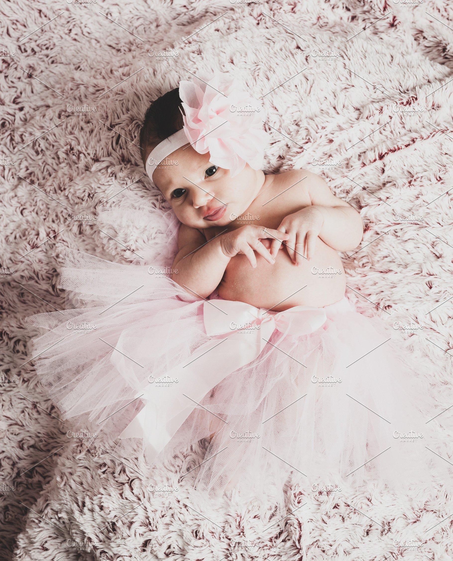 36ffebdcb Newborn baby girl wearing a pink bal ~ People Photos ~ Creative Market