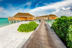 Wooden jetty and cabins on Maldives.