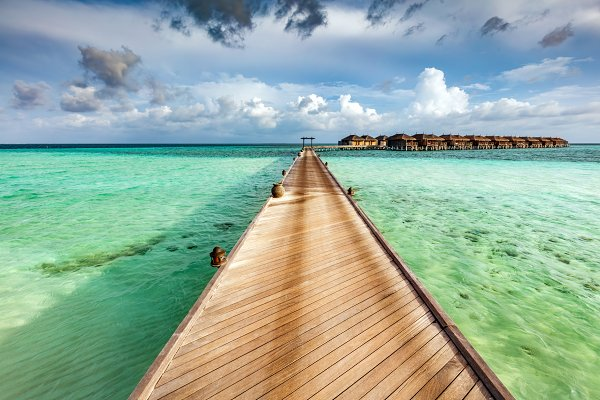 Wooden jetty on the ocean on Maldiv…