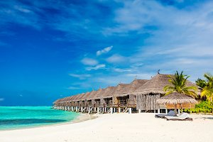 Tropical beach with straw cabins on