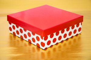 Red gift box with golden background