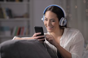 Happy girl listening to music checki
