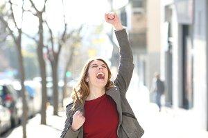Excited teen celebrating good news i