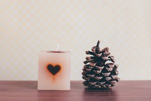 Candlelight and pine cone