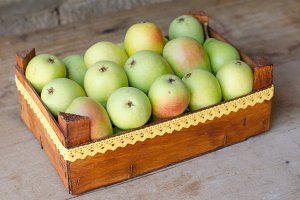 Wooden box full of ripe pears.