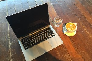 Laptop. Coffee. Wood Table.