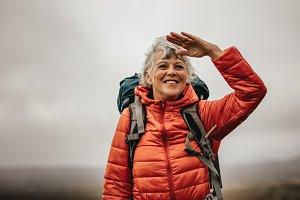 Woman trekker enjoying the beauty