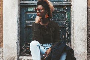 Black elegant girl on the porch