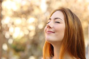 Beautiful woman doing breath exercises with a autumn background.jpg