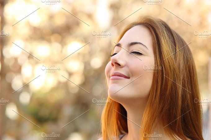 Beautiful woman doing breath exercises with a autumn background.jpg - Beauty & Fashion