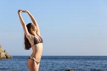 Beautiful fitness woman body wearing a swimsuit on the beach.jpg