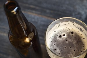 Beer bottle and glass with dark lage