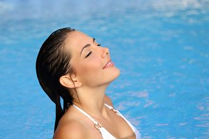 Beauty woman breathing while bathing in a pool in summer.jpg