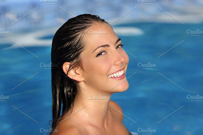 Beauty woman with perfect smile and skin on the water.jpg - Beauty & Fashion