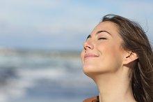 Closeup of a woman breathing fresh air on the beach.jpg