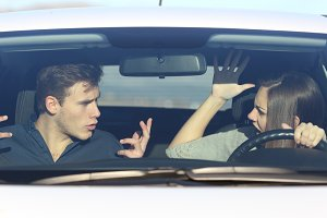 Couple arguing while she is driving a car.jpg