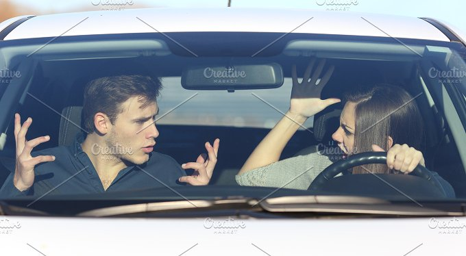 Couple arguing while she is driving a car.jpg - Transportation