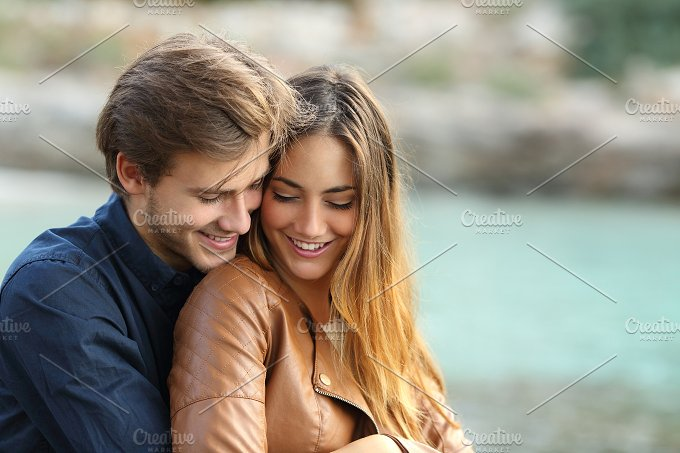 Couple cuddling affectionate on the beach.jpg - People