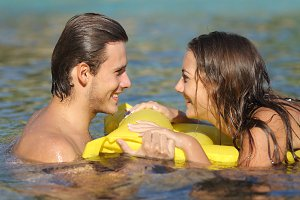 Couple in summer vacation bathing on the beach.jpg