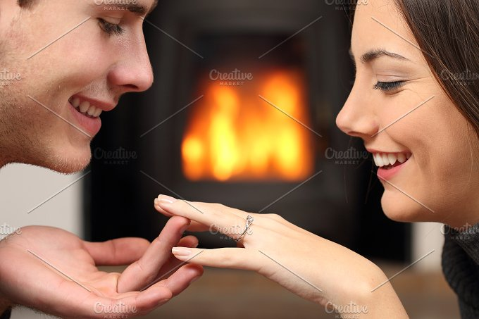Couple looking a engagement ring after proposal.jpg - People