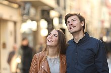 Couple looking above in the street of a city.jpg