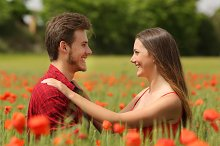 Couple looking each other affectionate in a red field.jpg