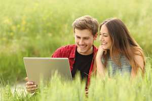 Couple or friends sharing a laptop.jpg