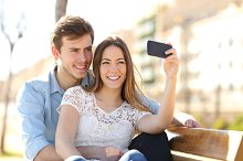 Couple photographing a selfie with a smart phone in a park.jpg