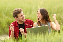 Couple singing and listening music from a laptop.jpg