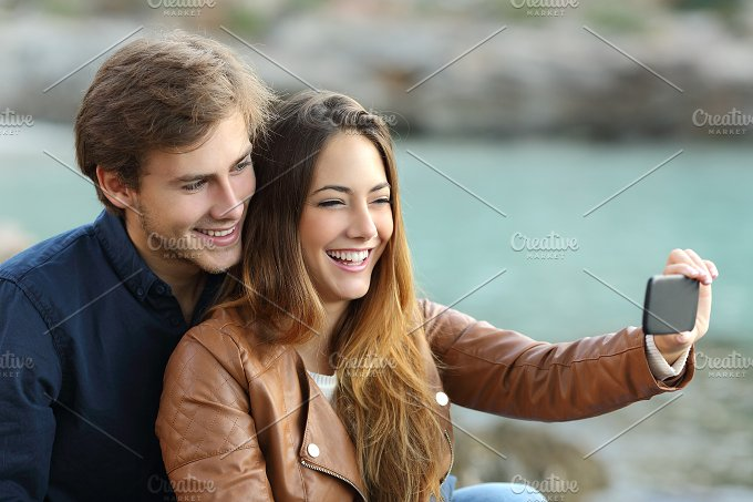 Couple watching videos in a smart phone.jpg - Technology