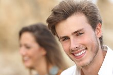 Handsome man portrait with a perfect white tooth and smile.jpg