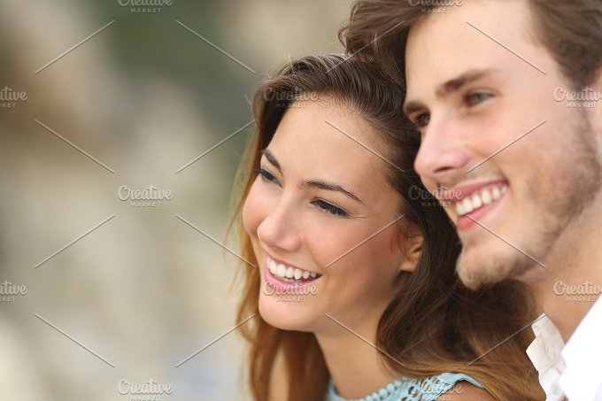 Happy couple in love looking away together.jpg - People
