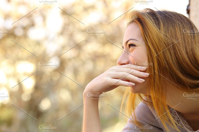 Happy woman laughing covering her mouth with a hand.jpg - Beauty & Fashion