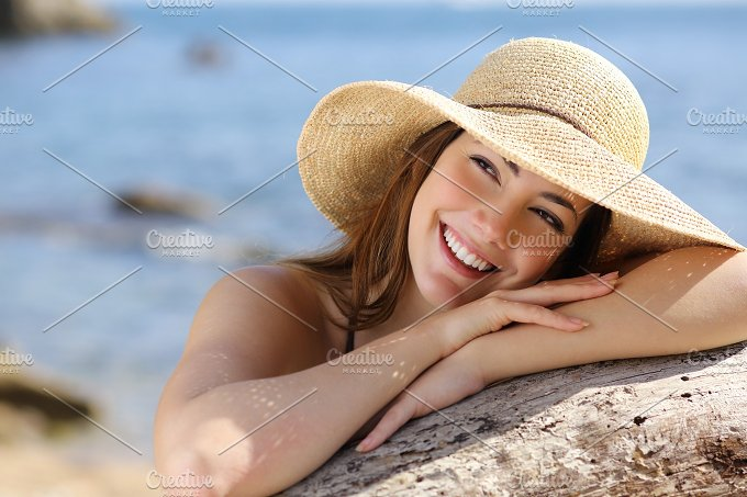 Happy woman with perfect white smile looking sideways on vacations.jpg - Beauty & Fashion
