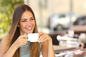 Pensive woman thinking in a coffee shop terrace.jpg