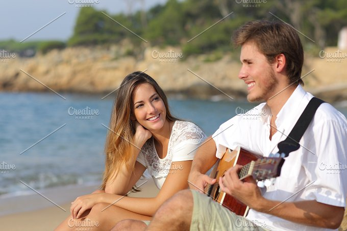 Man flirting playing guitar while a girl looks him amazed.jpg - Holidays