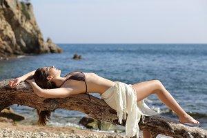 Sunbather beautiful woman sunbathing on the beach.jpg