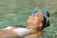 Tourist woman bathing on a tropical beach on holidays.jpg