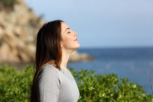 Woman breathing fresh air relaxed on vacation.jpg