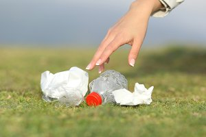 Woman hand collecting garbage in the mountain.jpg